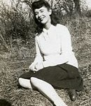 tn_Gardner Alberta Joy sitting on the grass c 1940s